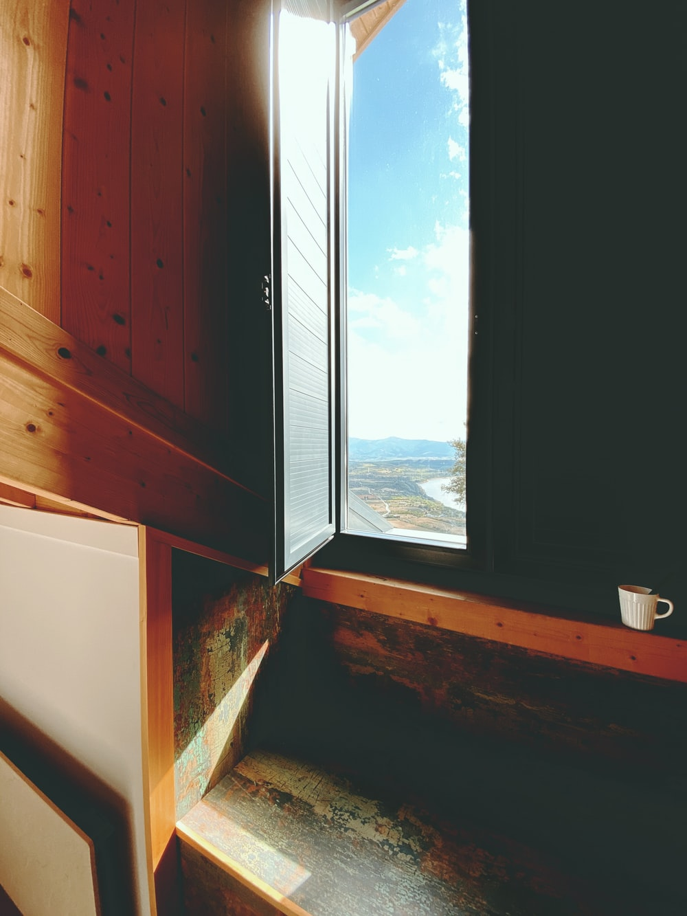 brown wooden cabinet beside window