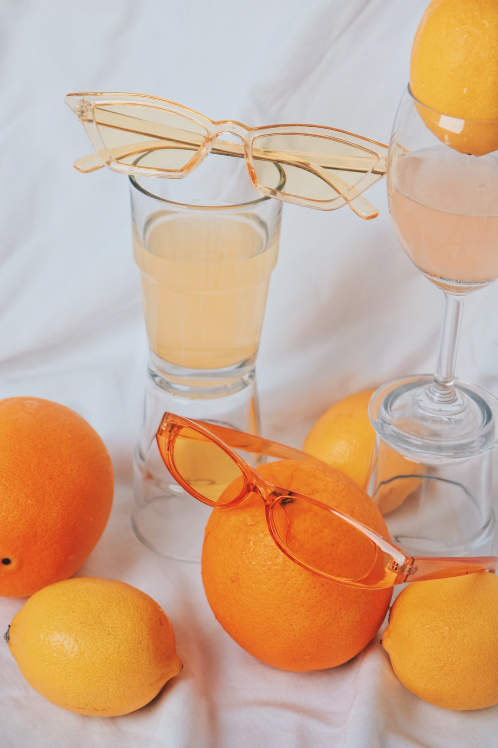 orange fruit on clear glass footed bowl
