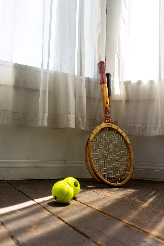 yellow and black tennis racket