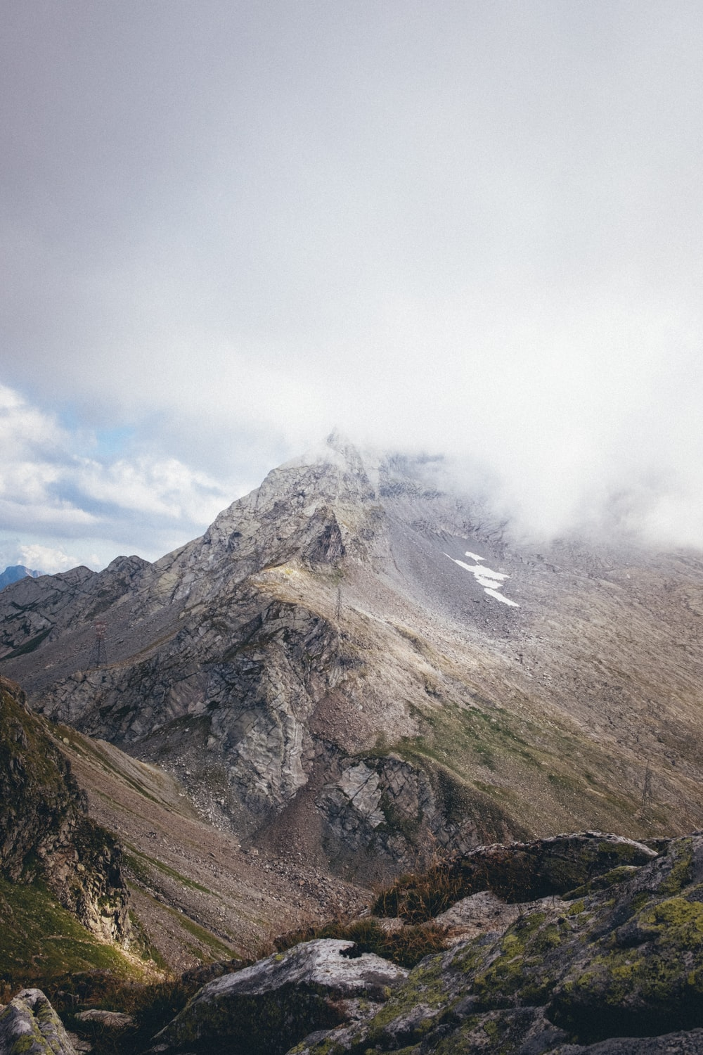 gray and brown mountain under white clouds during daytime