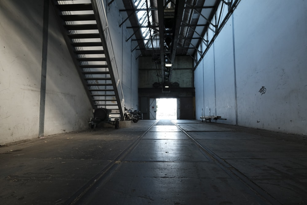 gray concrete hallway with white wall