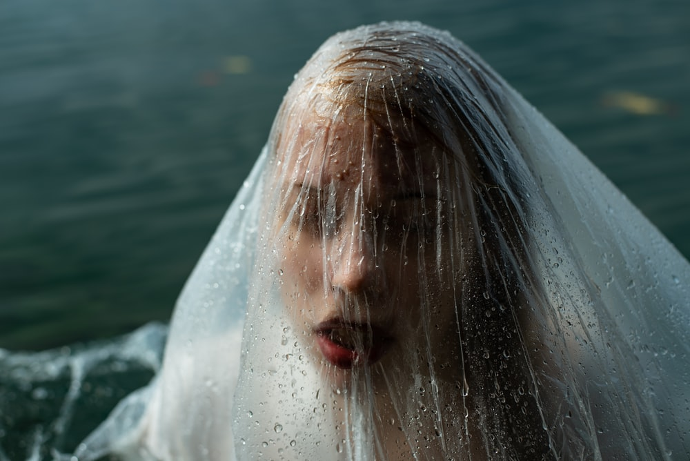 woman in white dress in water