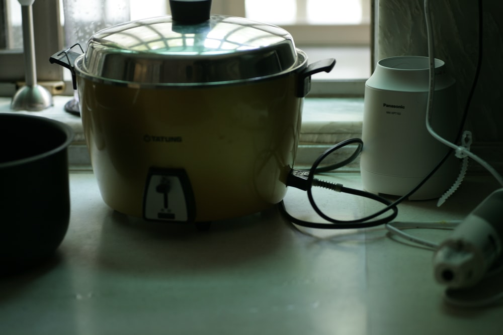 white and black rice cooker
