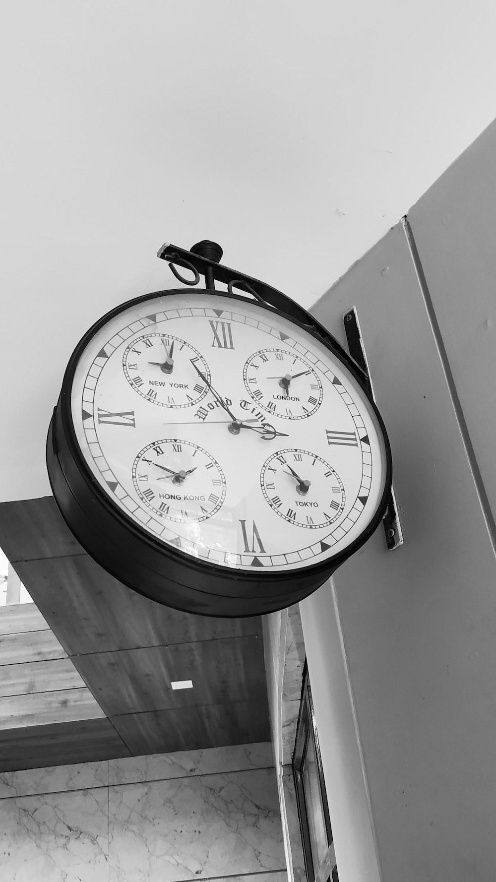 black and white round analog wall clock