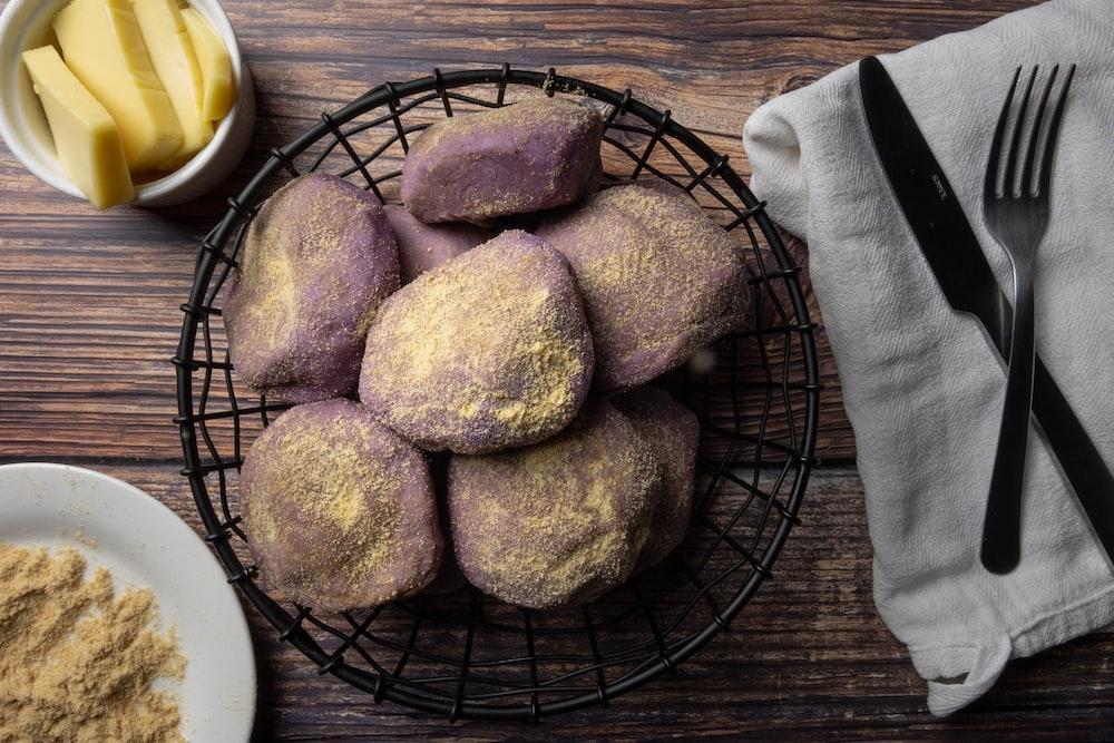 three brown breads on black metal basket