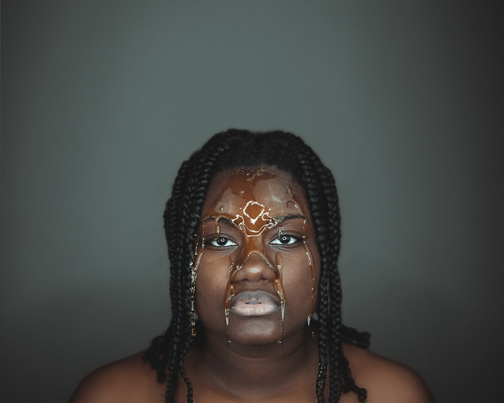 woman wearing silver beaded necklace