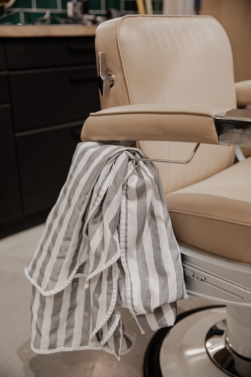 white and black textile on beige leather chair