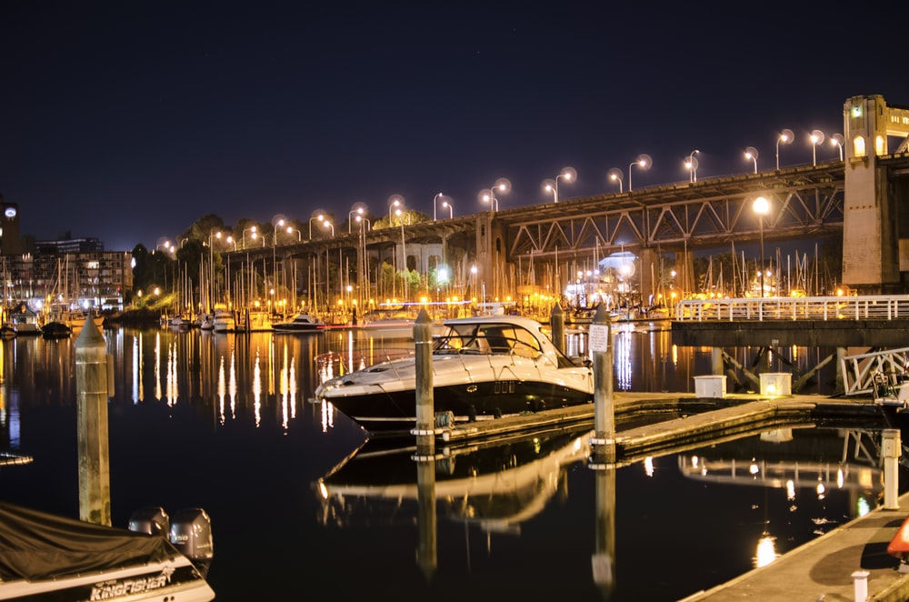 white and black boat on dock during night time