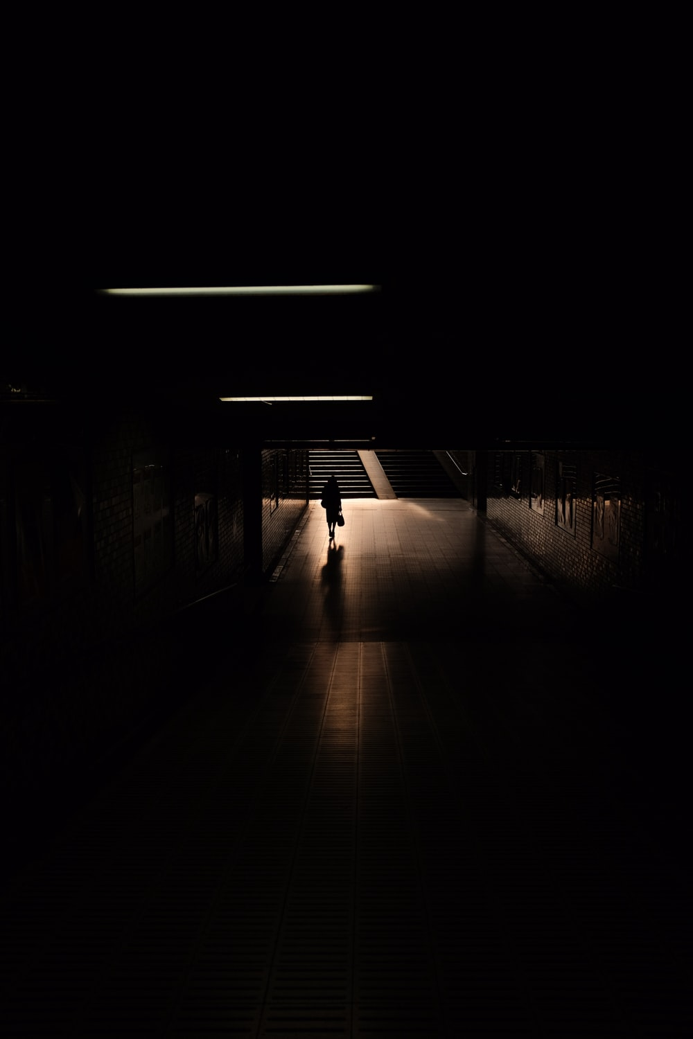 empty hallway with light turned on in the dark