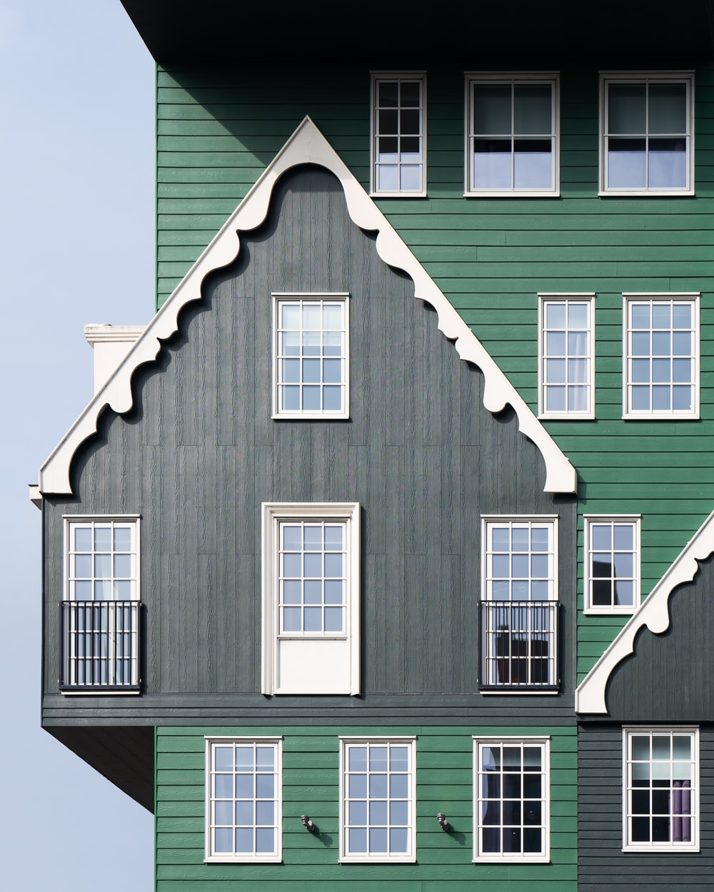 green and white wooden house