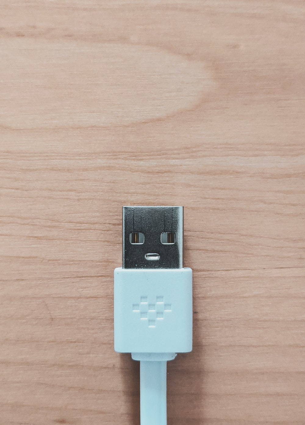 white usb flash drive on brown wooden table