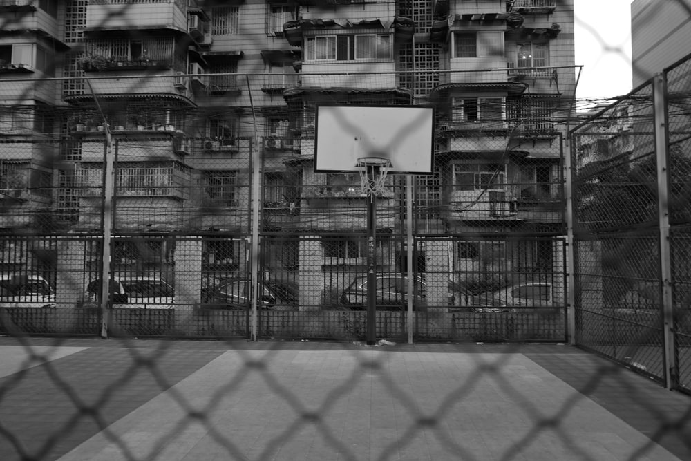 grayscale photo of chain link fence