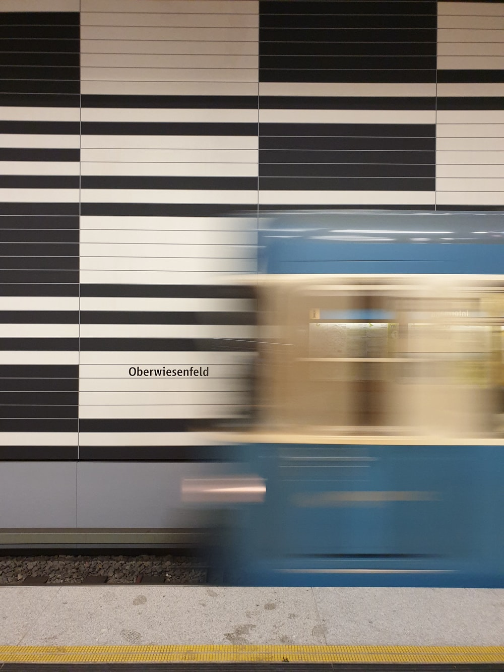 blue and white train in train station