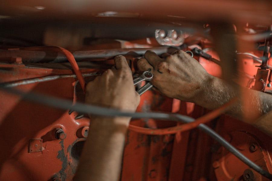 person fixing a car