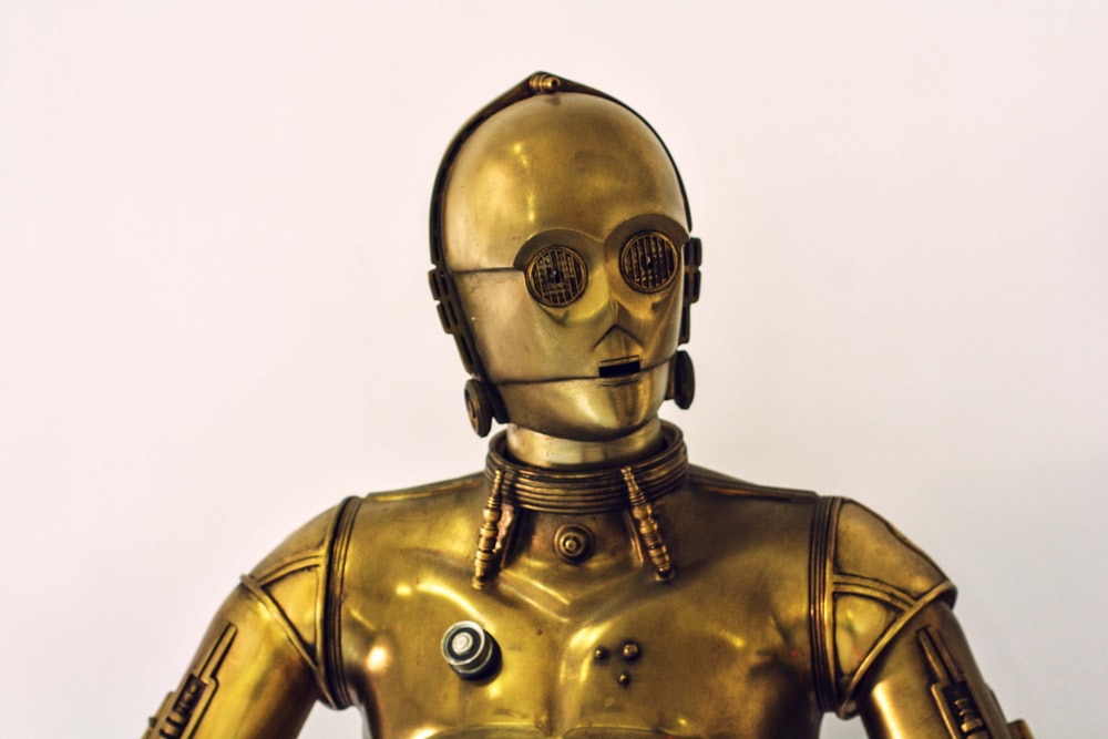 person wearing gold mask and mask