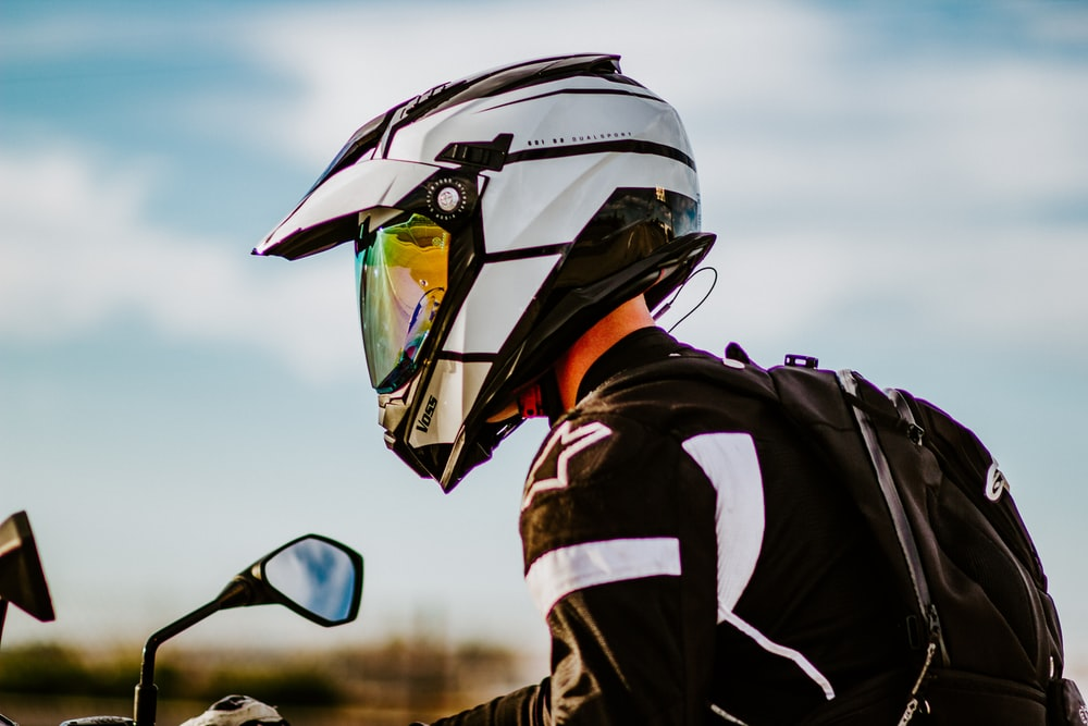 man in black and white jacket wearing black helmet and black goggles