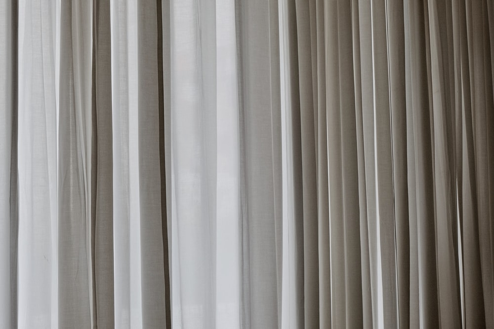 white and gray window curtain