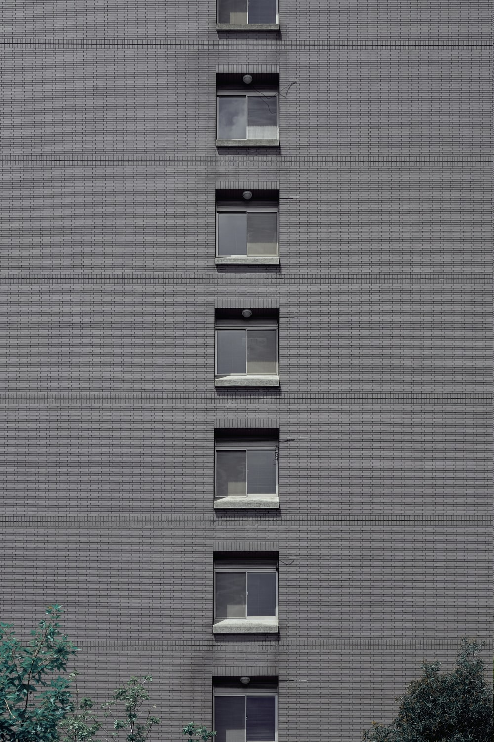 white wooden window frame on gray concrete building