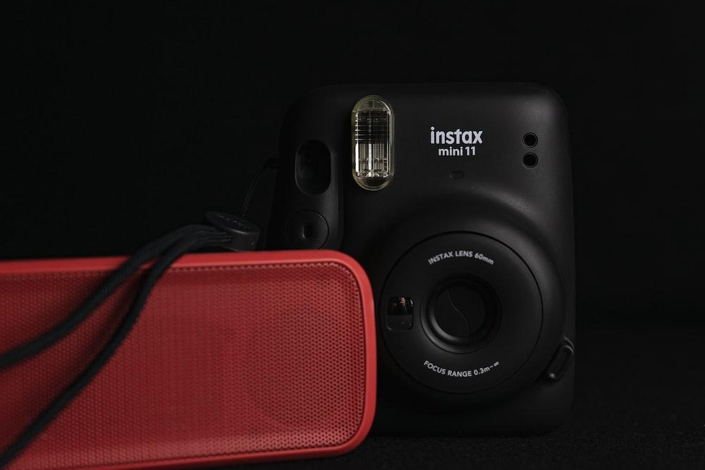 black canon dslr camera on black surface