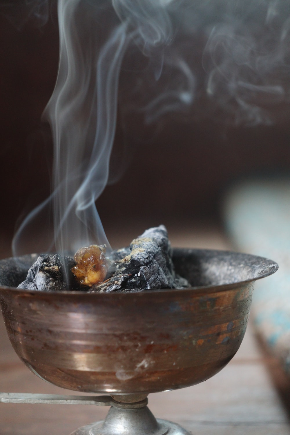 close up photo of gray round bowl with fire