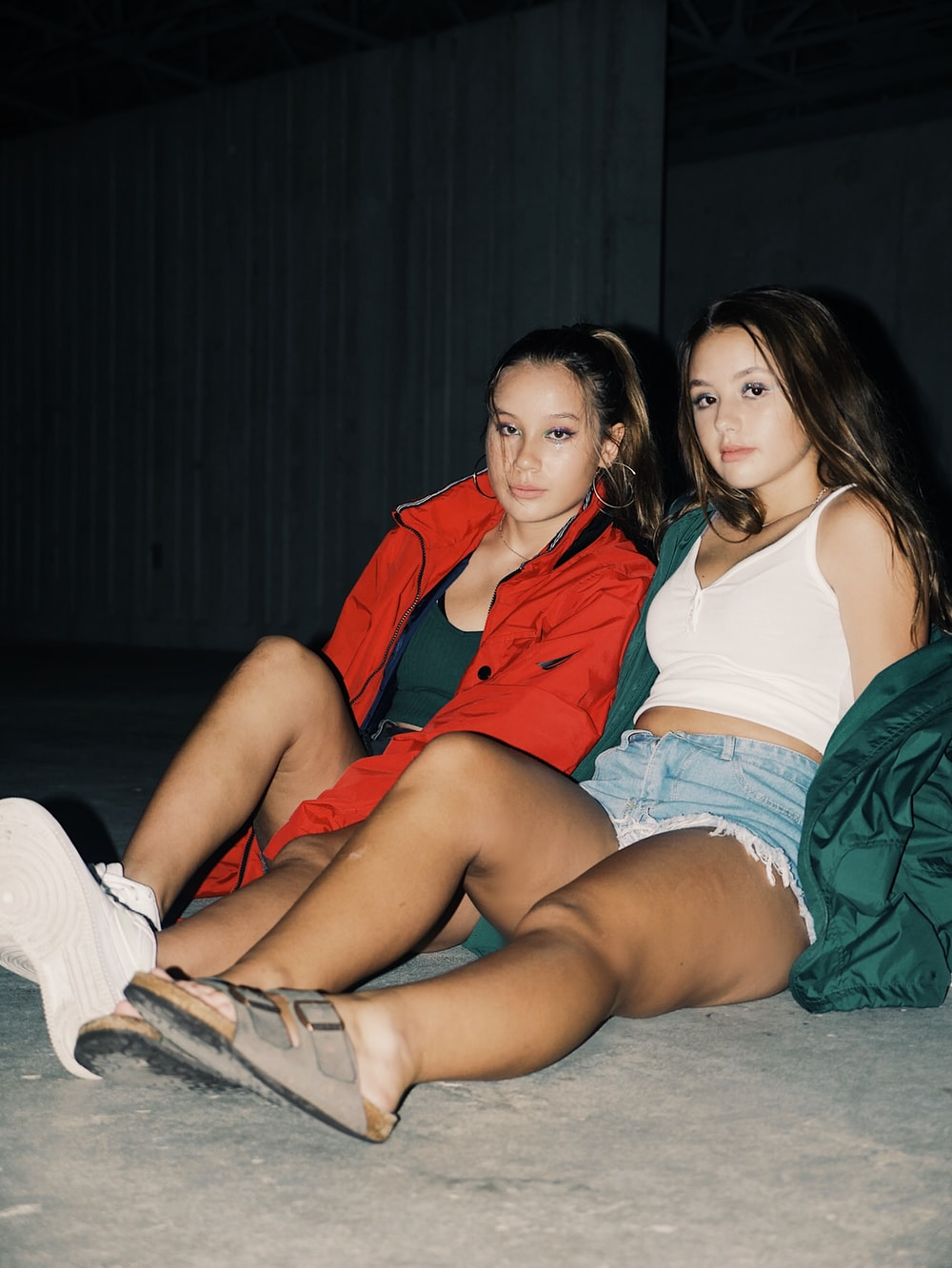 2 women sitting on floor