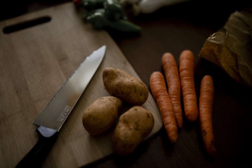 carrots on brown wooden chopping board