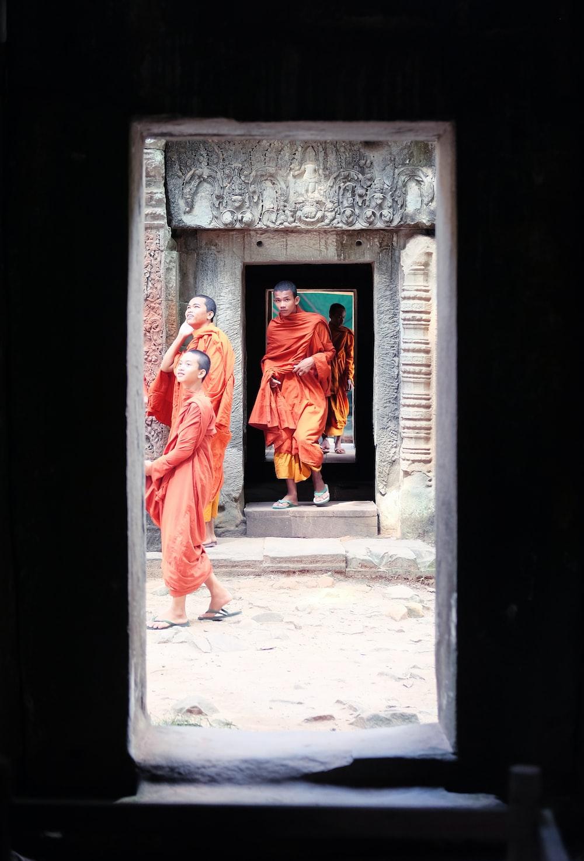 woman in red robe standing on doorway