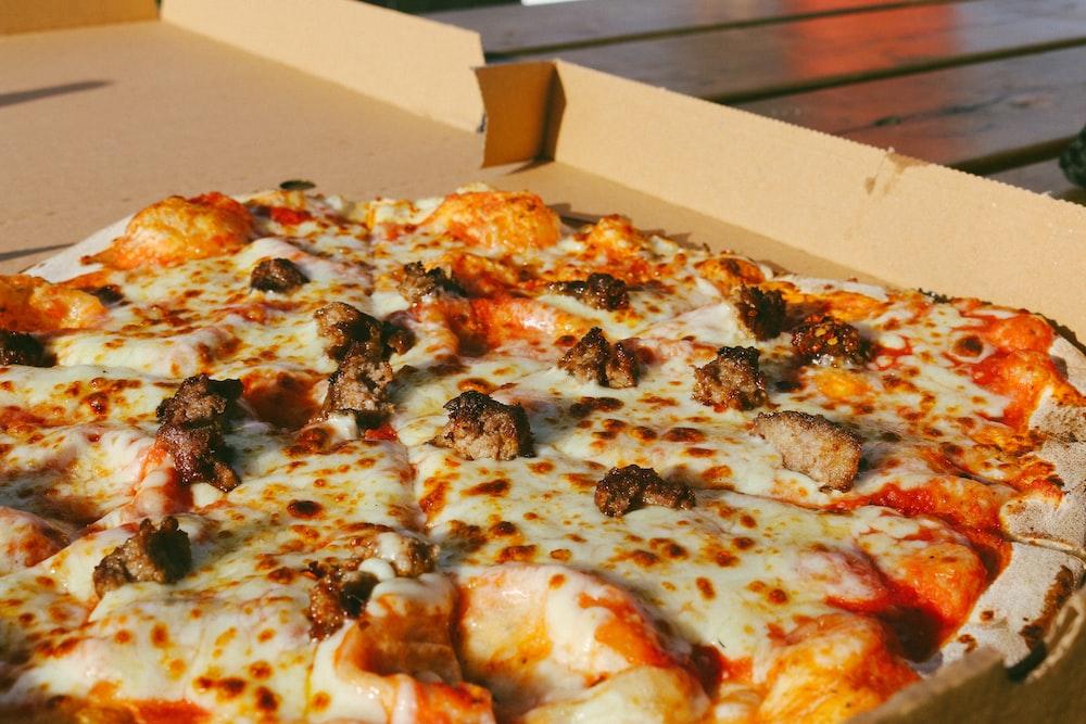 pizza on white cardboard box