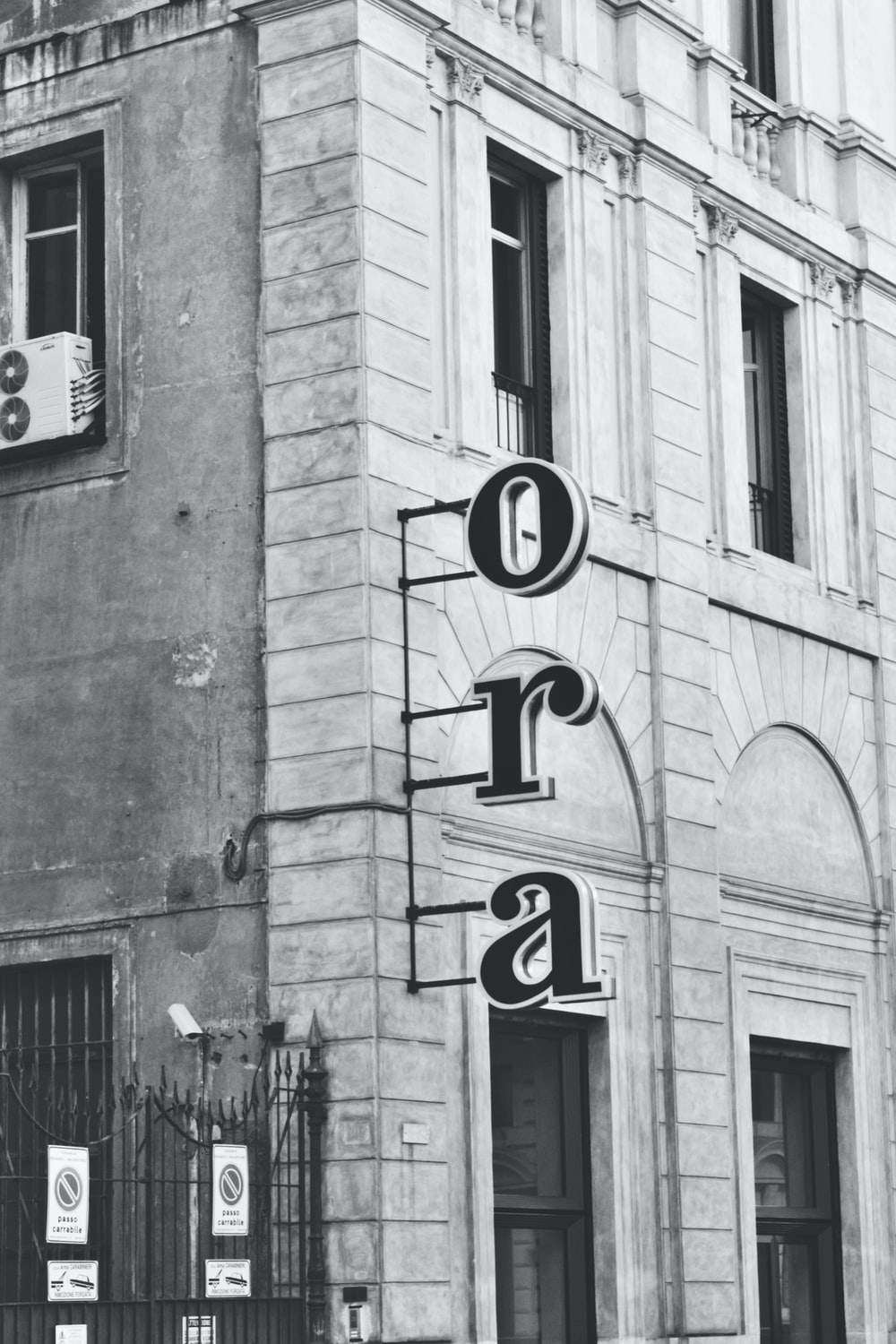 grayscale photo of love sign on building