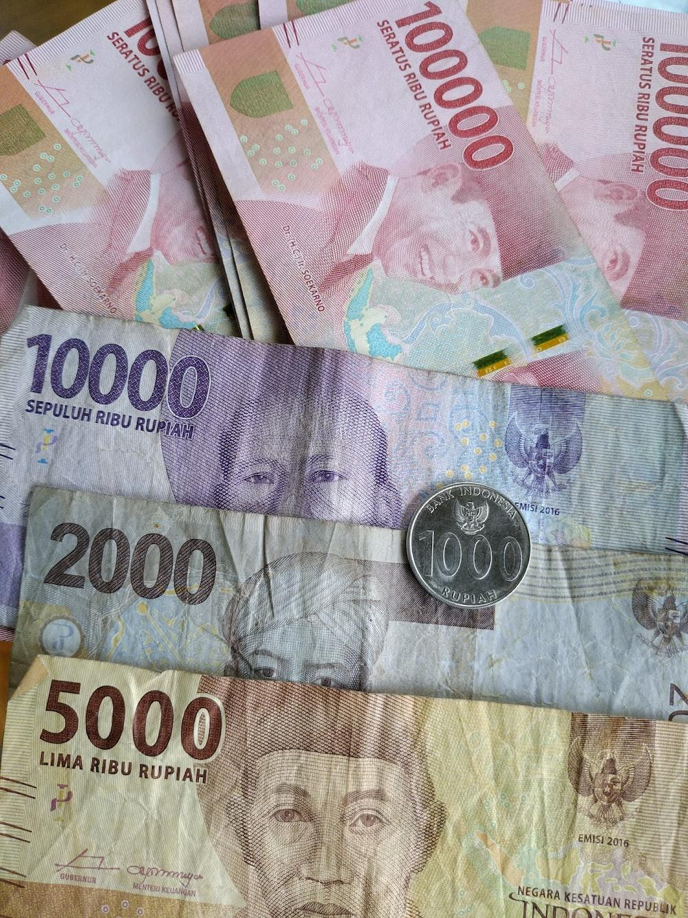1000 philippine peso bill on white textile