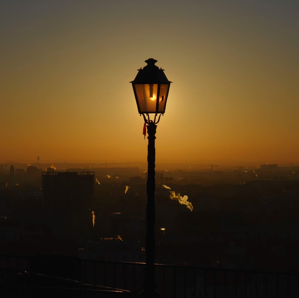 black street lamp during sunset