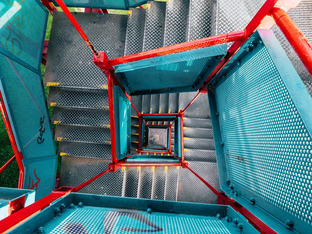 green and red metal ladder