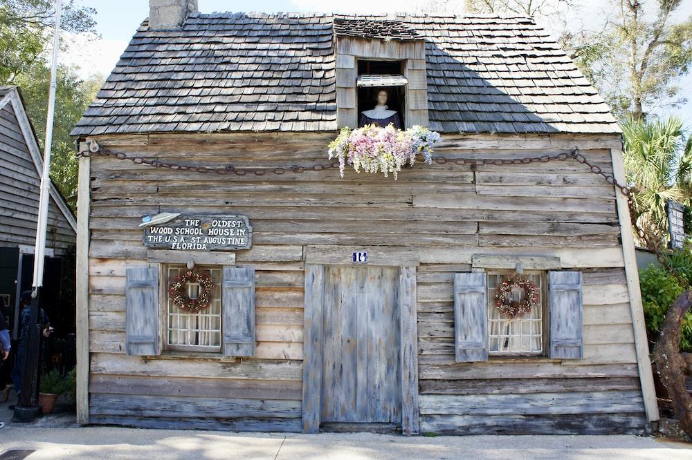 brown wooden door with flowers on top
