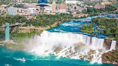 aerial view of city buildings near body of water during daytime niagara falls zoom background