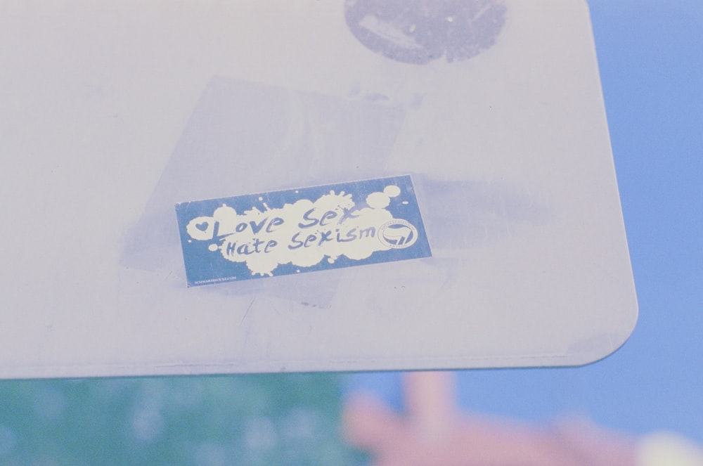 white and blue card on white paper