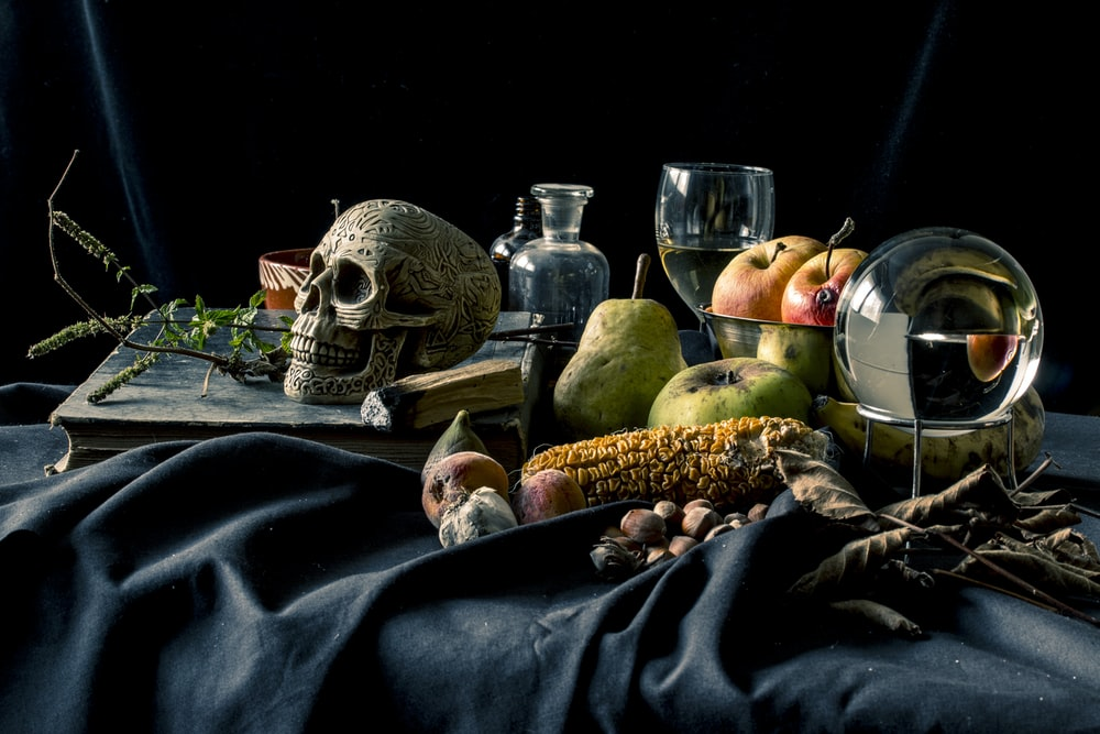 fruits on table with wine glasses and bottles