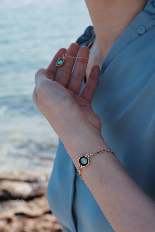 woman in blue dress wearing silver bracelet and silver bracelet