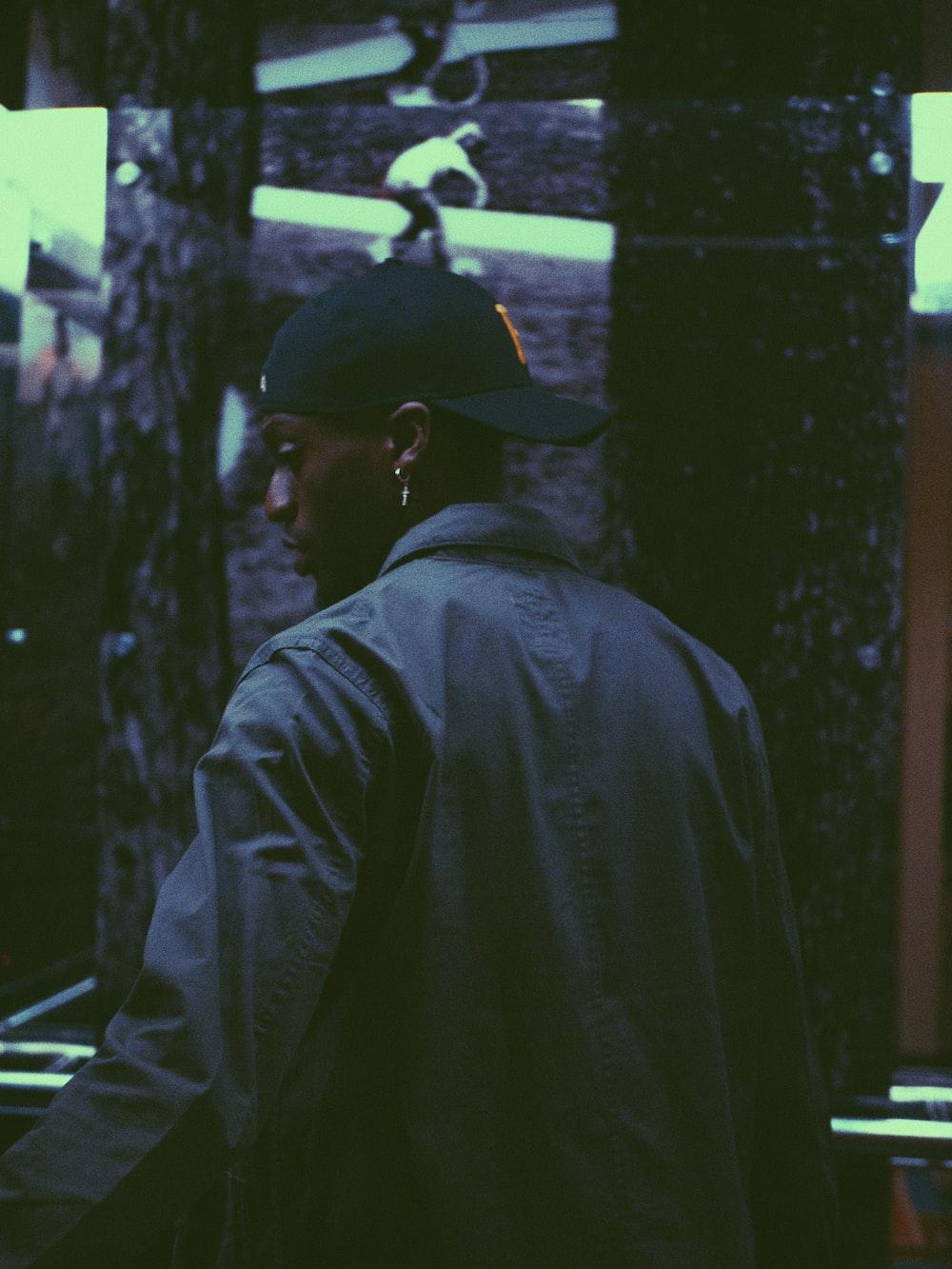 man in black hat and black jacket