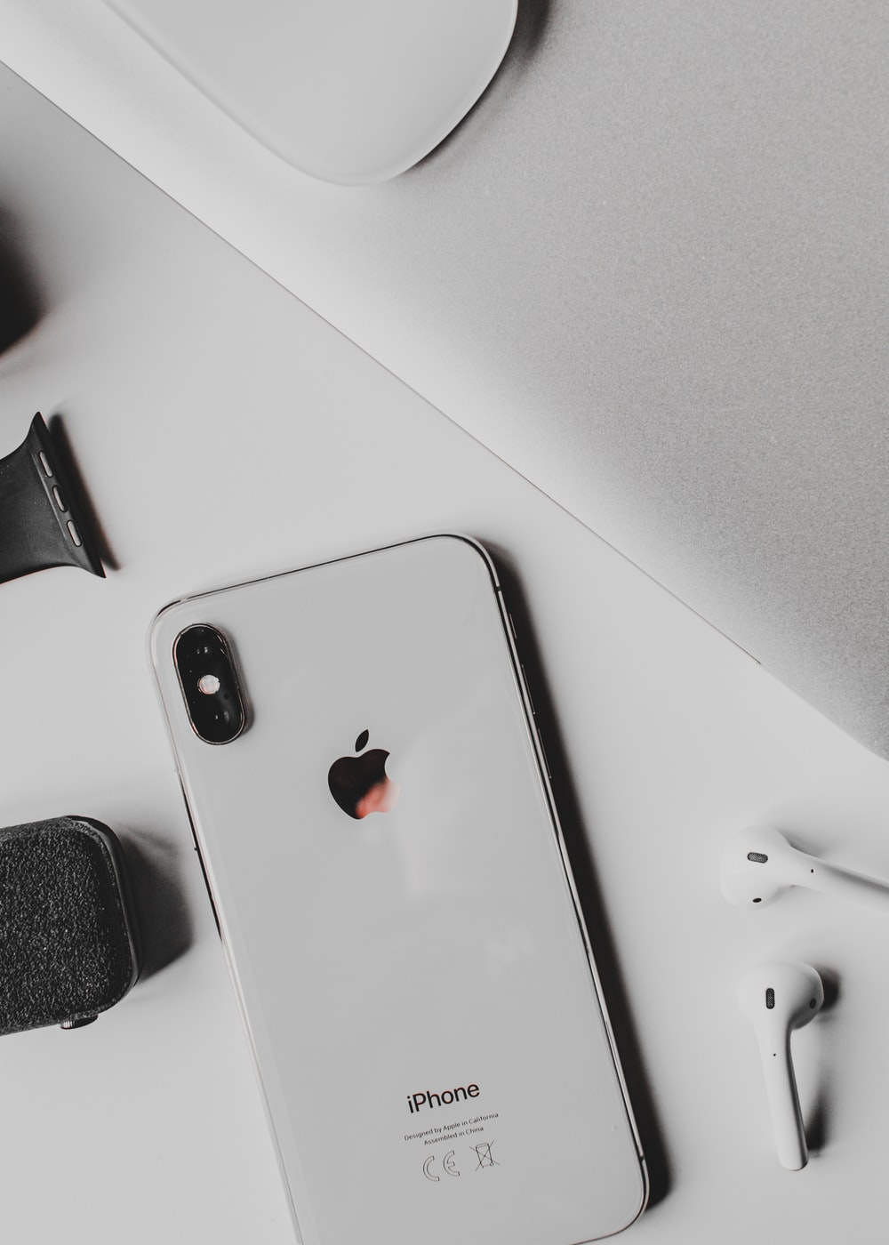silver iphone 6 on white table
