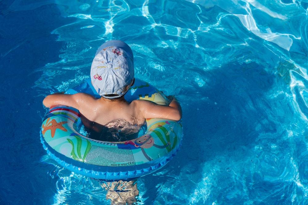woman in blue swimming cap in pool
