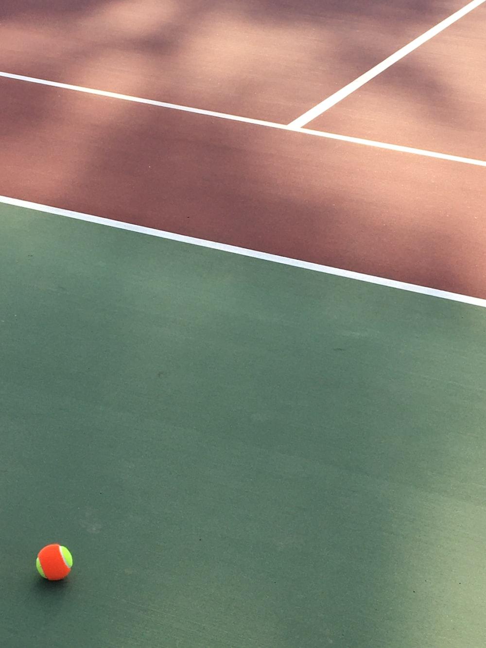 orange and green tennis ball