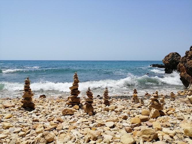 towers of rocks on a stony beach