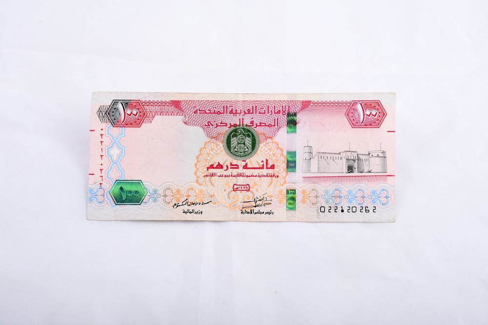 10 banknote on white table