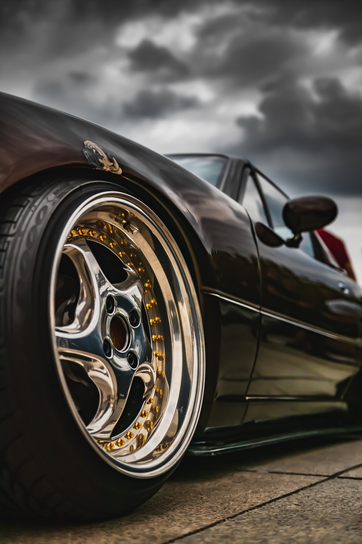 black car with chrome wheel
