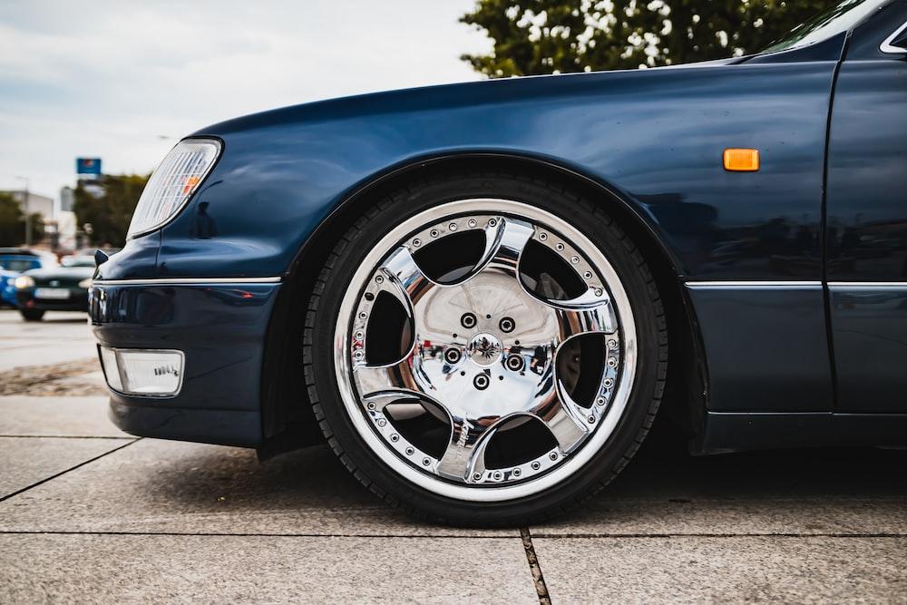 blue car with chrome wheel