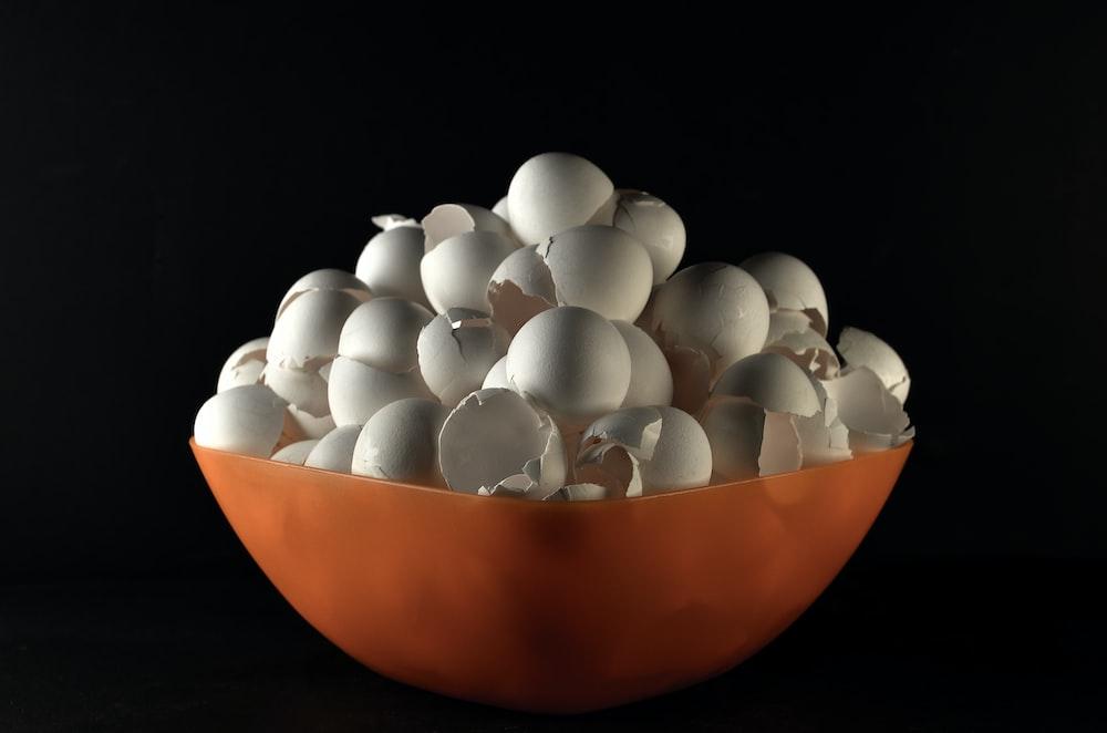 white egg on orange bowl