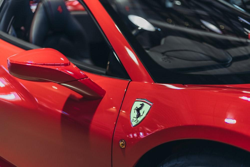 red ferrari car in close up photography