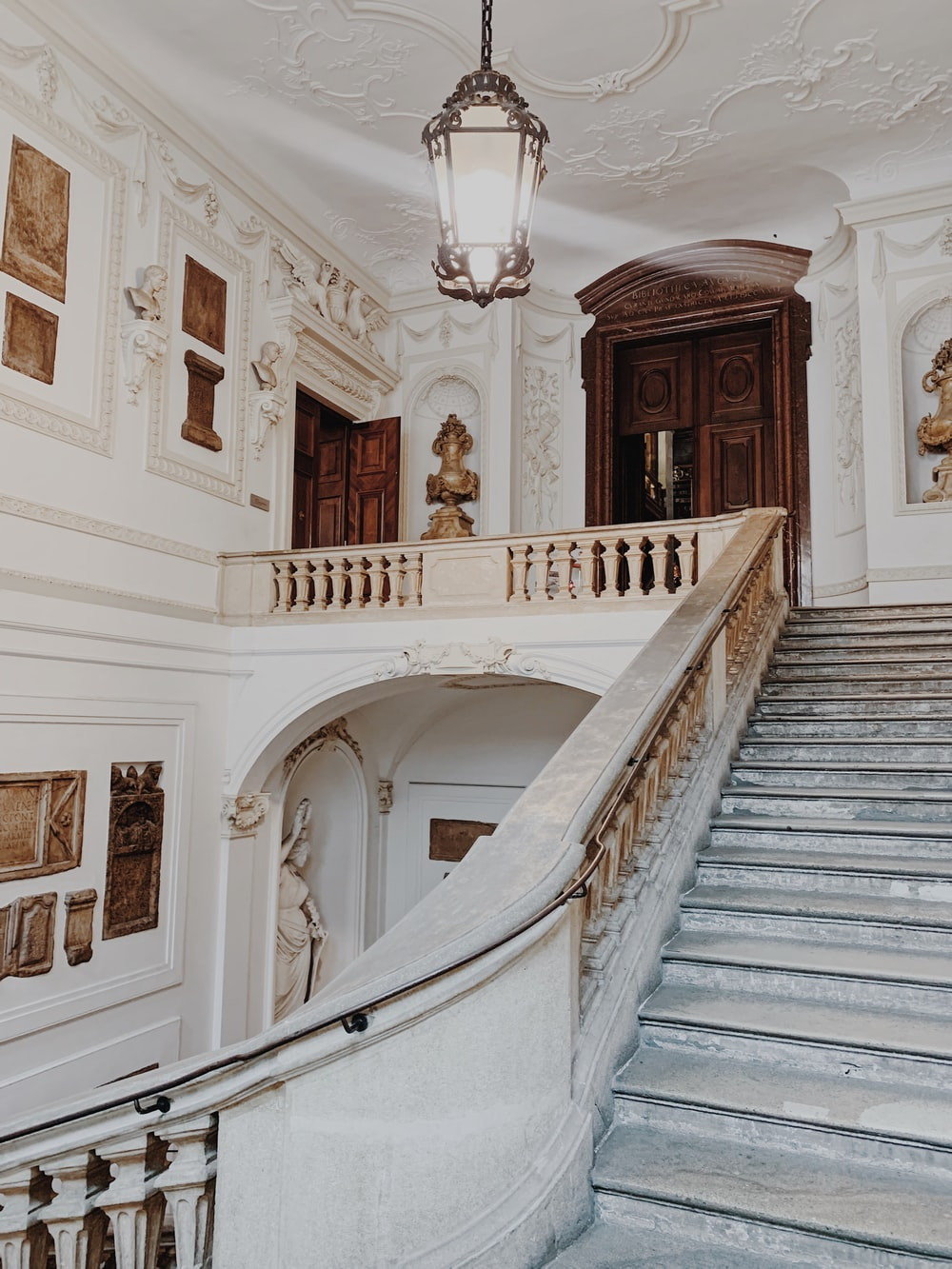 white and brown wooden staircase