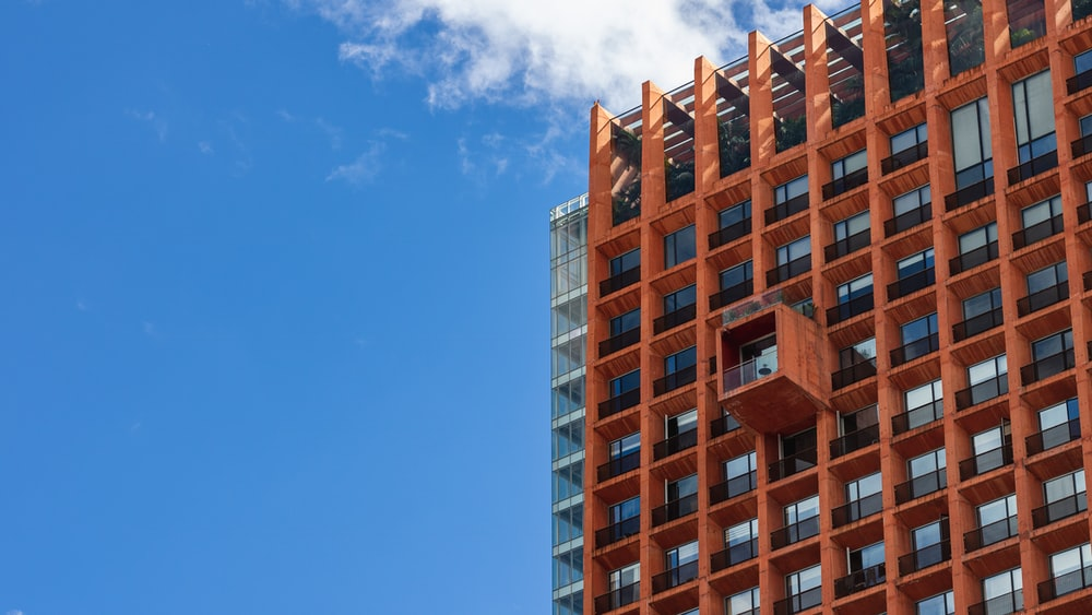 brown concrete building under blue sky during daytime