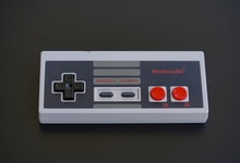 white and black nintendo game controller